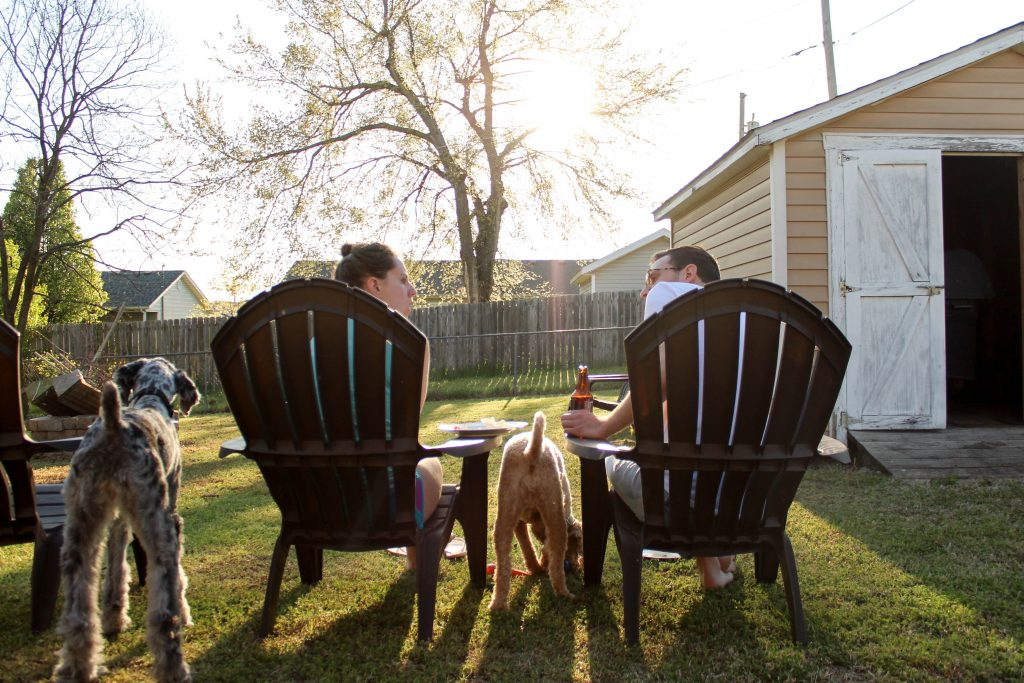 couple with dogs in backyard